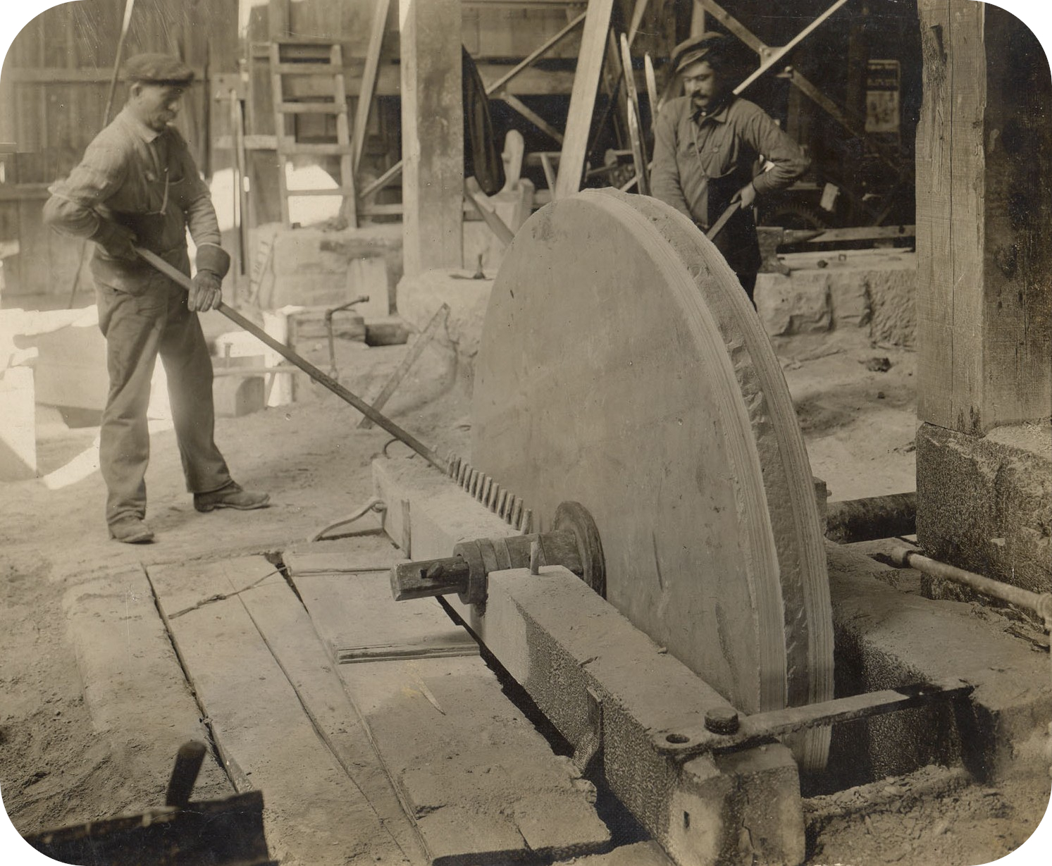 Men Grinding with Sandstone
